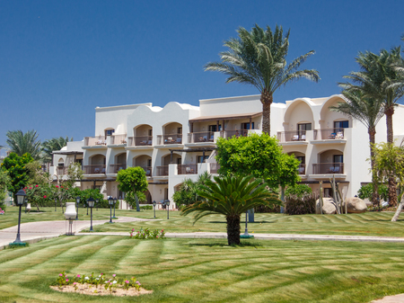 Tropical Hotel and palm trees, lawns and pathway