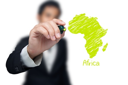 Businessman drawing a map of continent Africa.