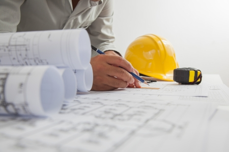 Architect sketching a construction project.
