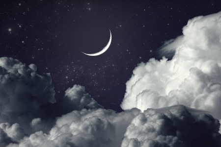 cloudy night sky with moon a