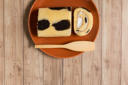 Cake roll with cow-skin pattern inserted with fresh milk cream.