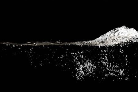 Photo pour close up of water waves splash and bubbles isolated on black background. - image libre de droit
