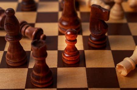 Photo pour Pawn among other chess pieces, close up. - image libre de droit