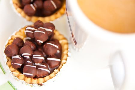 Chocolate dessert and cup of coffee