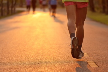 Runner running in the light of evening