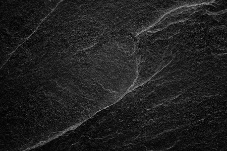 Foto de Dark grey black slate background or abstract natural stone texture. - Imagen libre de derechos