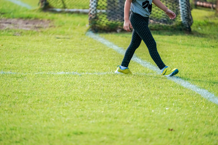 Photo pour girl is in the football field. - image libre de droit