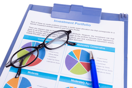 investment Portfolio document with eye glasses and pen on white background