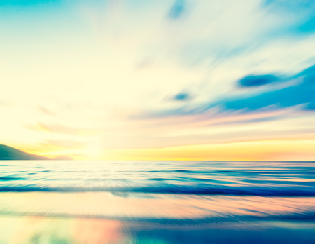 An abstract seascape with blurred zoom motion with cross-processed colors on paper background