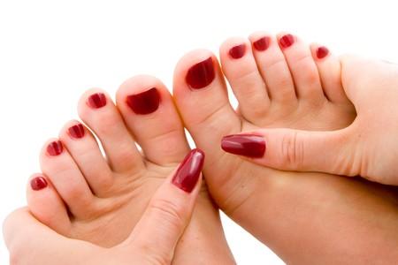 Photo pour Woman feet massage isolated in white background - image libre de droit