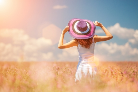Photo for Woman in the field with flowers - Royalty Free Image