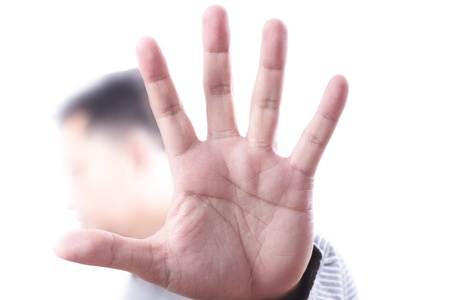 Photo pour Abstract to stop sign with men hand - image libre de droit