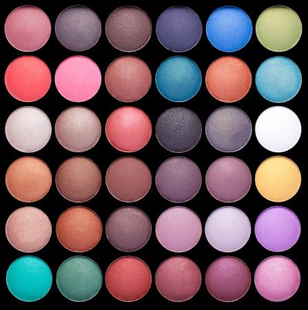 Make-up colorful eyeshadow palettes isolated on black background