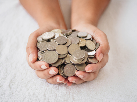 Woman hands holding coins on white background. saving money, finacial concept.