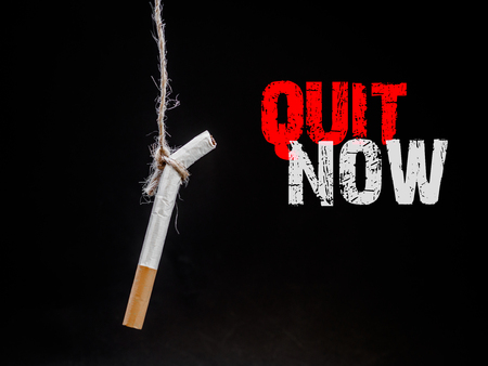 Photo pour hanging cigarete on black background. kill yourself.  Quitting smoking concept. world no tobacco day - image libre de droit
