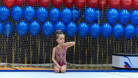 Foto per Adorable sporty little girl in rhythmic gymnastics. - Immagine Royalty Free
