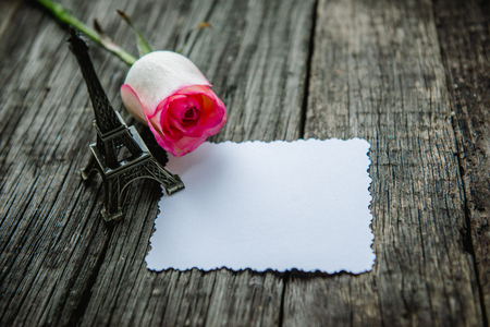 Declaration of love, the rose with a ring on a wooden board.