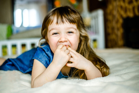 Adorable smiling little girl waked up in her bed. Adorable smiling little girl waked up in her bed