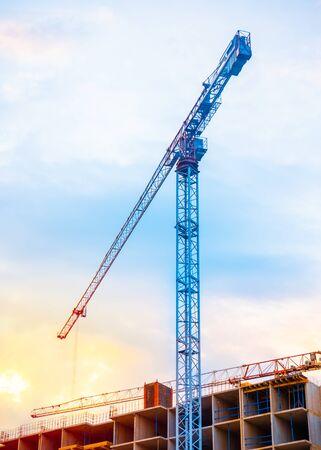 Photo pour Construction cranes on blue sky with sunset background. - image libre de droit