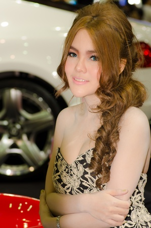 BANGKOK, THAILAND - DECEMBER 6: Unidentified female presenter at RUF booth in THE 28th THAILAND INTERNATIONAL MOTOR EXPO 2011 on December 6, 2011 in Bangkok, Thailand.