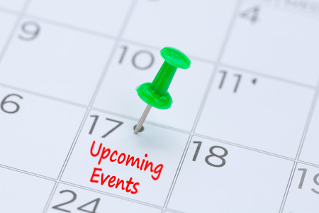 Photo pour Upcoming Events written on a calendar with a green push pin to remind you and important appointment. - image libre de droit