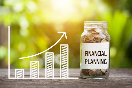 Photo pour Financial planning word with coin in glass jar and graph up. - image libre de droit