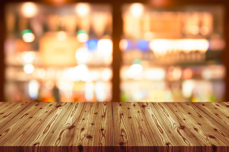Foto de Empty wooden table top with blurred of coffee shop, cafe, bar background, Abstract background can be used for display or montage your products. - Imagen libre de derechos