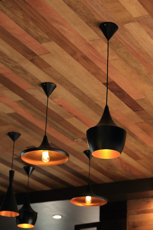black pendant lamp on ceiling wood wall