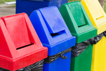 colorful of recycle bins in the garden