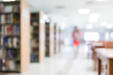 Photo pour library blur background with student and bookshelf - image libre de droit