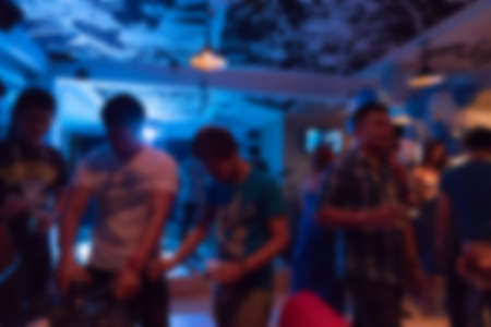 Photo pour image blurred background, group of young people having joyful dancing in nightclub party - image libre de droit