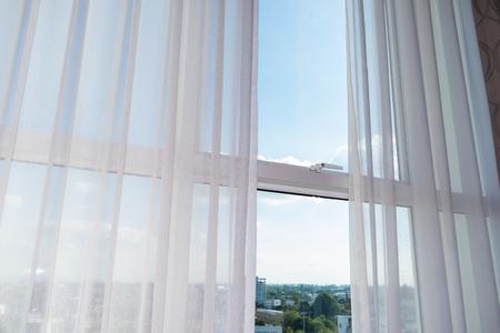 Photo pour white curtain on glass window - image libre de droit