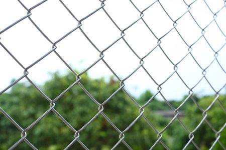 Photo for chain link wire fences enclose border area - Royalty Free Image