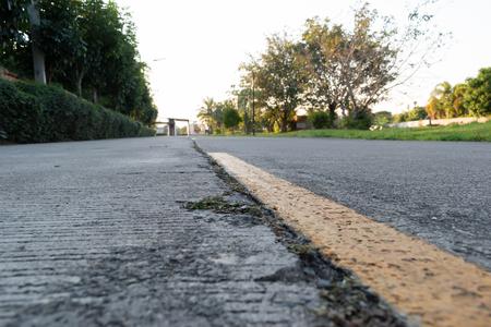 Photo pour yellow line marking on old cement road - image libre de droit