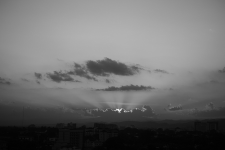 Photo pour image black and white monochome, light rays of sun in sunset sky above the city - image libre de droit