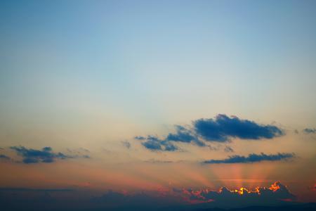 Photo pour light rays of sun above clear blue sky - image libre de droit