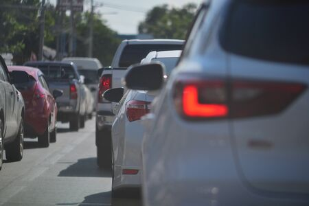 Foto de people driving car on road traffic jam with rush hour in the city - Imagen libre de derechos