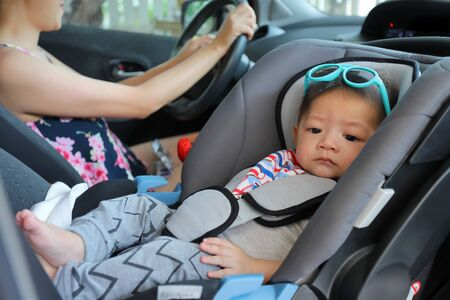 Photo for mother and son drive road trip family travel in summer vacation day, cute baby boy sitting on car seat - Royalty Free Image