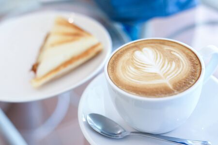 Photo pour hot latte coffee drink and sandwich put on table breakfast in the morning day - image libre de droit