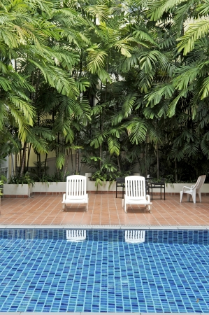 swimming pool and chairs