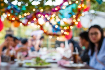 Blurred image of People are having fun at the dinner party, Elegant abstract foreground with bokeh defocused lights.
