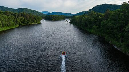 Photo pour inflatable motor boat. fishing boat on a mountain river. Anyui River. Khabarovsk territory, far East, Russia. - image libre de droit