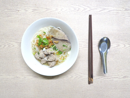 Pork noodle in soup.