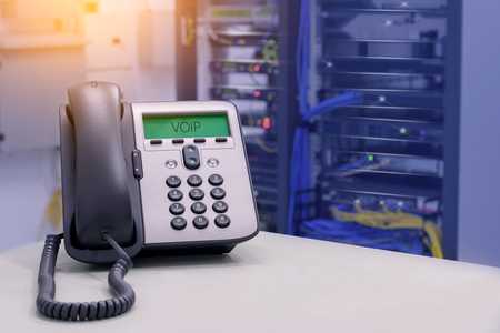 Photo pour VOIP Phone (IP Phone) in data center room - image libre de droit