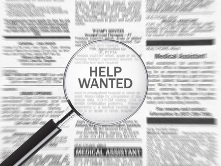 Help wanted ad through a magnifying glass