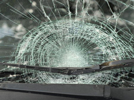 Insurance Theme: Shattered Glass Window of a Car after an Accident