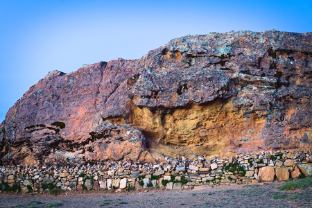 The Rock of the Puma (Titicaca) popular archeological site, a sacred place of the Tiwanaku and Inca cultures, on Isla del Sol (Island of the Sun) in Lake Titicaca, Bolivia photographed at sunset