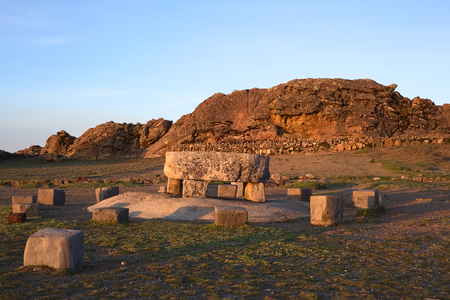 The Ceremonial Table and behind it the Rock of the Puma (Titicaca) popular archeological sites of Tiwanaku and Inca origin on Isla del Sol (Island of the Sun) in Lake Titicaca, Bolivia photographed at sunset