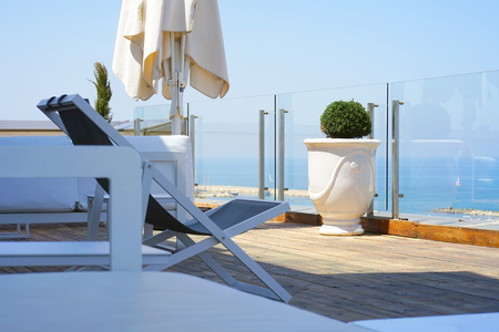 Photo for Interior of a large hotel balcony, villas. Beautiful balcony with white divans. White interior concept of a large balcony balcony. White color view of the morning horizon of the sea, the ocean. - Royalty Free Image