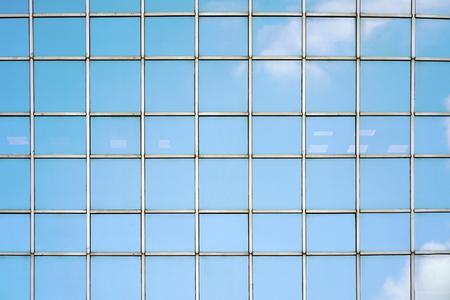 Photo pour Glass blue Windows of facade modern city business building skyscraper. Modern apartment buildings in new neighborhood. Windows of a building, texture. - image libre de droit